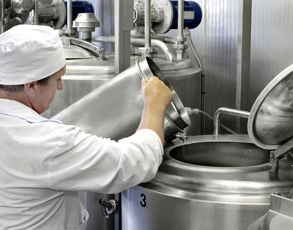 image of a worker on a modern milk factory